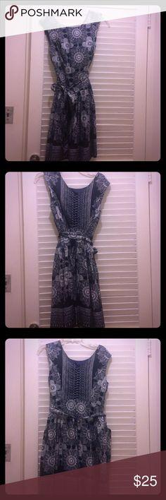 Super cute summer dress! Sleeveless, navy blue and white knee length dress. Sash ties around the waist. Robbie Bee Dresses