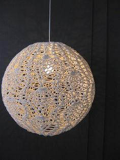Design Indaba Expo 2010: Moonbasket Lighting - Made in South Africa by local craftswomen, a line of crocheted globe lamps with a socially conscious twist