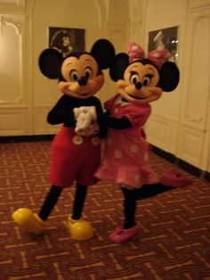 Mickey & Minnie Mouse in their traditional Mickey Mouse Clubhouse outfits