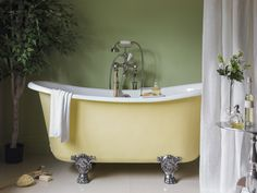 The #pastel yellow of this bath by Catchpole and Rye is an excellent match for Pantone's Colour of the Year 2017, #Greenery. #pastelyellow #bath #bathroom