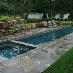 Crazy paving & stone wall around pool screams YES