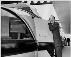 A very proud Walt Disney poses with the Monorail as it waits for passengers in the Disneyland Hotel    He looks like he's about to cry