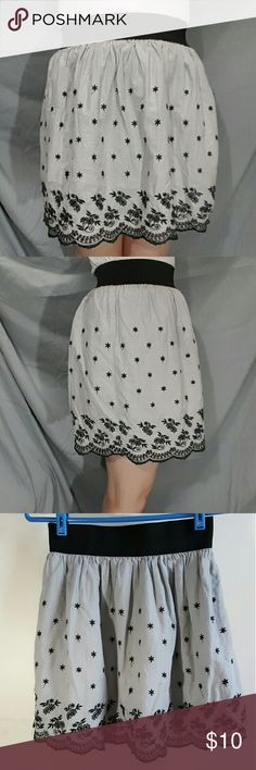 Grey embroidered skirt with elastic waistband This adorable skirt has an embroidered hem and little flowers all over it. It's a cute flowy skirt and the pictures don't do it justice. It has a lining and the waistband has a lot of stretch. ~measurements~ Taken flat  Waist- 12 1/2 - 17 in  Hip- free Length- 17 in Please check with another piece of clothing to ensure a correct fit  Thanks for looking rhapsody  Skirts Circle & Skater