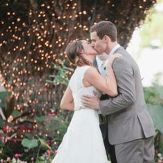 Sometimes your ceremony backdrop can be as simple and pretty as a tree trunk wrapped with twinkle lights!
