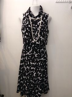 ALC black and white two piece sleeveless top and skirt with longer hem line in front and back. Size 10. Please call (949) 715-0004 for all inquiries.
