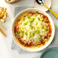 Hot Pizza Dip Recipe -You can assemble this effortless appetizer in a jiffy. The pizza-flavored dip goes very fast, so you may want to make two batches. —Stacie Morse, South Otselic, New York