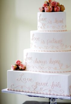 """This beautiful wedding cake is decorated with the words """"Love is Patient, Love is Kind, Love Always Hopes, Love Never Fails"""". Cake # 008."""