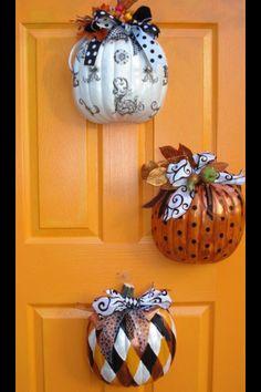 Cut dollar tree pumpkins in half and decorate!