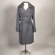 Grey Bebe coat with removable faux fur shawl Brand new and authentic. Removable faux fur collar that can be bottom on or off. Removable waist belt. Very stylish and elegant winter look bebe Jackets & Coats