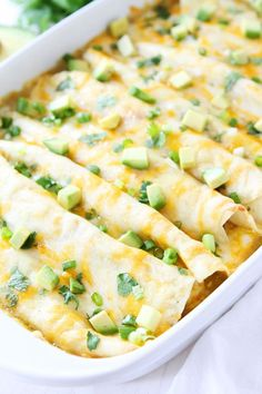 Creamy Spinach and Cheese Green Chile Enchiladas Recipe on twopeasandtheirpod.com Great for dinner recipe and they freeze well too!