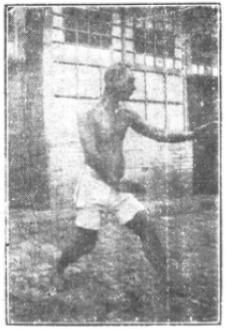 A practitioner stands in san ti (three bodies) posture- a signature power development stance of the xing yi quan (form & will boxing) system.
