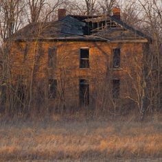 Abandoned farm between Ada and Kenton, Ohio. Looks like it's sunset for both the sky and this house.