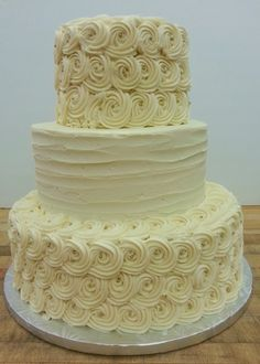 Gold dragees and buttercream rosettes make this cake stunning!