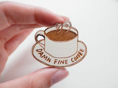 An engraved wooden brooch, inspired by David Lynchs Twin Peaks. Cooper really loves his coffee!  The design has been hand drawn and engraved onto 3mm laser grade birch plywood using a laser cutter. It is approximately 4cm in diameter. The item will be wrapped in tissue paper and shipped in a bubble lined envelope to keep it safe.  If youd like the brooch in a gift box, please purchase the following listing along with your order…