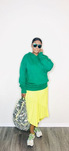 How to Style: Not Your Average Neon Ready to take your neon to the next level? Try one bright piece. I chose this slime green skirt and stuck with green hues from head to toe. The skirt stands out but all green everything pulls the look together.  #neontrend #springtrends2019 #amerikabstyleme