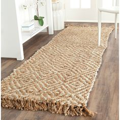 Safavieh's Natural Fiber collection is inspired by timeless contemporary sisal designs crafted with the softest jute available.This rug is crafted using a hand-woven construction with a jute pile and Manado, Braided Area Rugs, Decoration Entree, Diy Carpet, Wall Carpet, Sisal Carpet, Frieze Carpet, Carpet Ideas, Plush Carpet