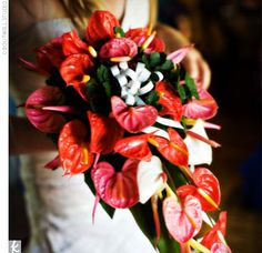 "For her bouquet, Tiffany's only request was that the flowers be ""colorful and tropical."" Luckily, when you're getting married in Fiji, that'..."