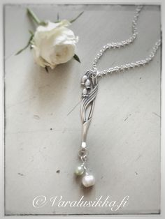 """Hand made """"Lily of the Valley"""" spoon necklace made from vintage silver plated spoon and sea pearl beads. www.varalusikka.fi"""