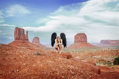 black angel wings surrounded by the epic desert scenery of Monument Valley