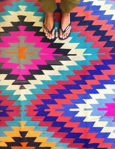 These Turkish Kilim Rugs are a perfect mix of colour and pattern - we think they scream SUMMER! via Table Tonic