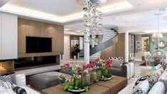 salon moderne avec tables basses en bois, ottomans gris devant la cheminée, suspension boules et orchidées