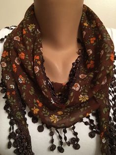 A personal favorite from my Etsy shop https://www.etsy.com/listing/275185148/brown-floral-scarflace-trim-scarfwomens