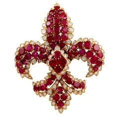 the fleur de lis, a classic motif, in this1960s David Webb ruby and diamond pin