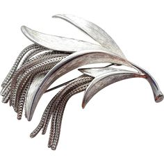 1960s Brooch with fluid metal fringe, Mid Century Modern, unsigned Trifari. Measurements: 2-1/2 inches X 2-1/4 inches. Minty and such a great example