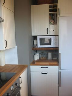 IKEA Stat Kitchen. Microwave shelf cut from butcher block countertop material.