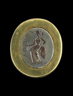 "From a tomb in Tillia Tepe, Afghanistan, a piece of first century jewelry depicting the goddess Athena. The image of Athena is from the national museum in Kabul, and the photograph was taken in 2006 when the piece was among those in the ""Afghanistan, Rediscovered Treasures"" exhibition at Musee Guimet in Paris, France. Though much war and looting has resulted in loss of many of Afghanistan's antiquities, this is among those that survive."
