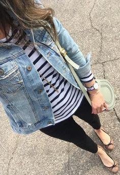 a jean jacket, a stripe top, black jeans, tan flats