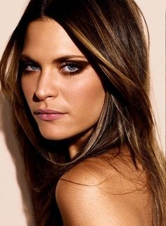 Beautiful sun-kissed blonde pieces give gorgeous brunette hair dimension and frames the face.