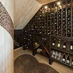 Wine Cellar Photos Under Stair. Love the colors.