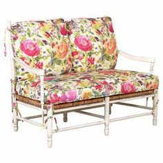 "Bring garden-chic elegance to your living room or master suite with this lovely wood-framed loveseat, showcasing woven accents and floral-print cushions for a splash of cottage charm.  Product: LoveseatConstruction Material: Wood and cottonColor: MultiFeatures:  Woven accentsFloral printCushions includedDimensions: 35"" H x 23"" W x 16"" D"