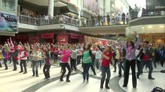 "I Believe She's Amazing Flash Mob - Toronto Eaton Centre.Uploaded on May 28, 2010 http://www.IBelieveShesAmazing.com Kim MacGregor organized this flash mob of 200 dancers to launch the ""feel good"" movement, ""I Believe She's Amazing"" in honor of her friend Erika Heller who passed away May 28th, 2009 at 31 yrs. old...this is her living legacy. The amazing choreographers and dancers pulled this together in just one-6 hr rehearsal the day before the shoot."