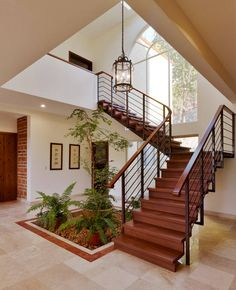 Staircase Space Idea Creative Ways To Use The Space. These staircase decorating ideas will give your entryway a step up, tones of green and had built-in shelving that made the space feel small. Home Stairs Design, Railing Design, Home Room Design, Modern House Design, Interior Stairs, Small House Design, Facade Design, Indian Home Design, Dream House Plans