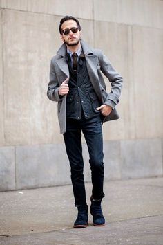 Men's Blue Gingham Dress Shirt, Dark Brown Tie, Navy Quilted Gilet, Grey Pea Coat, Navy Jeans, and Navy Suede Boots