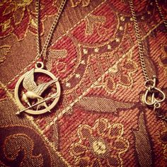 Hunger Games Necklace on Etsy, $5.00