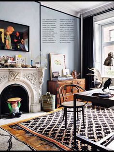 This living room's stormy gray-blue walls are the perfect counterpoint to the honeyed brown woods, and liberal use of black.  Drama and whimsy go hand in hand in this fun, hip space, filled with tribal textures, and vintage curiosities.