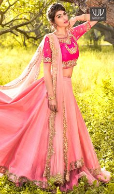 Dashing Pink Color Georgette A Line Lehenga Choli This pretty piece is a fairy tale that begins to unfold as you reveal your beauty in it. This pink raw silk a line lehenga choli add the sense of elegant and glamorous. This attire is beautifully adorned with sequins work.