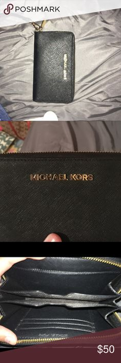 A black mk small wristlets This is a small black small sized wristlets from Michael kors. It is black with gold and is the perfect size. Will go threw PayPal! MICHAEL Michael Kors Bags Wallets