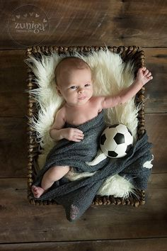 Newborn photography with soccer ball