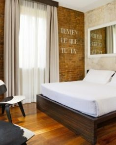 Relais Orso (Rome) Distressed concrete and bare brick walls feature in the funky rooms. #Jetsetter