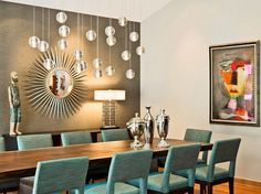 Modern dining room with turquoise chairs. HomEdit.