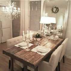 In love with this rustic table with glam setting and lighting.