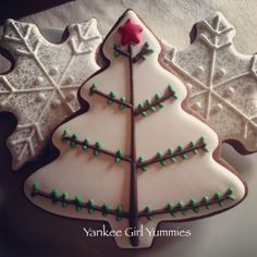 Christmas tree cookies and snowflakes, made by yankeegirlyummies on etsy.