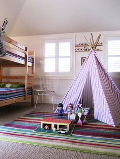 Striped rug and teepee from IKEA. Vintage Harry Bertoia chair