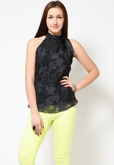 Black coloured top for women by Species. Made from polyester blend, this sleeveless top has waist length.