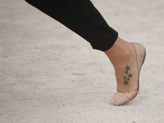 pretty star tattoo for the feet