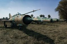 Forgotten MiGs are a collection of abandoned MiG-21 andSu-22 aircraft in Hungary. The aircraft have been neatly lined up in a farmers field at the side of a disused runway. These were formerly part of the Hungarian Airforce (Hungarian:Magyar Légierő). They bare traditional tail insignia; aligned triangles which point towards the front of the aircraft with colours matching the Hungarian flag. On modern in-service aircraft this insignia has been replaced by NATO standard grey-on-grey (low…